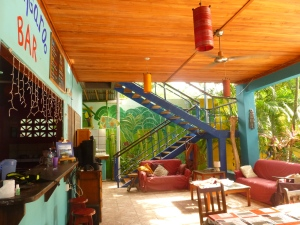 The main communal area with the bar, pool is just off to your left.