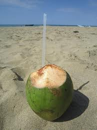 pipa on beach with straw